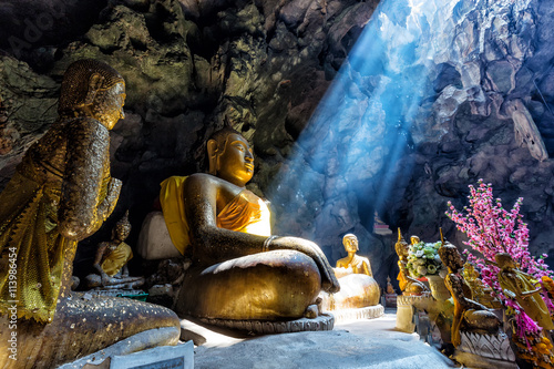 Spoed Foto op Canvas Boeddha Amazing Buddhism with the ray of light in the cave