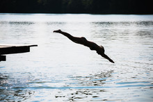 Woman Jumping Into The Lake