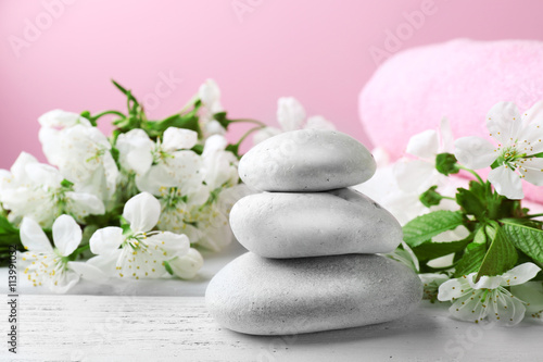Foto op Canvas Zen Spa treatment with blooming branch on wooden table