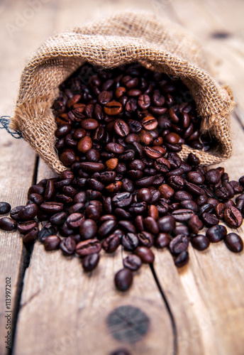 Fotografie, Obraz  Coffee beans on the wooden background. Hot drinks.