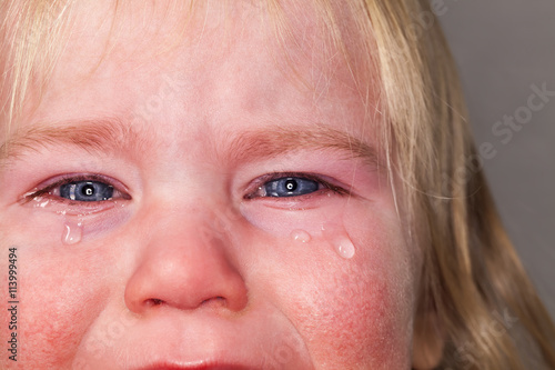 Fotografía  portrait of emotional tears crying baby toddler blond long hair