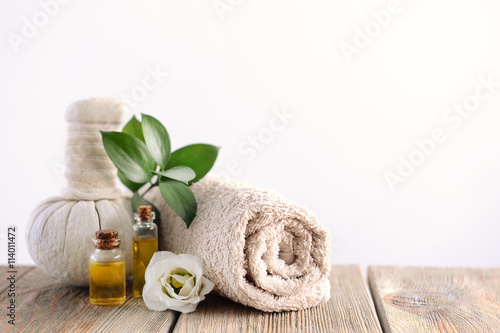Spa composition with towel on light background