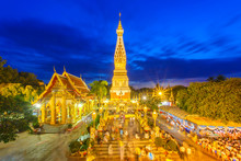 Thai People Walking With Lighted Candles In Hand Around A Temple Candles Light Trail Of Pagoda At Phra That Phanom Temple On Visakha Bucha Day, Nakhon Phanom Province, Thailand
