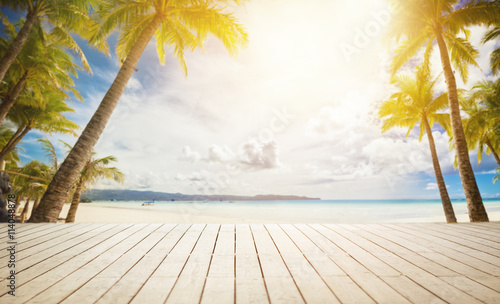 Deurstickers Strand wooden dock with tropical background