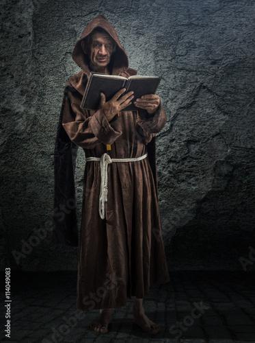 Senior monk, priest holds in his hand the Bible Fototapeta