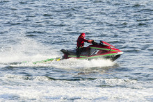 Lifeguards In Jet Ski In Rescue Training