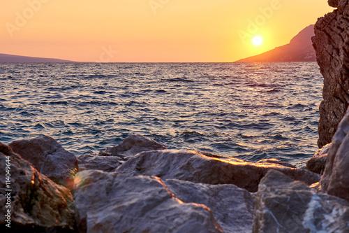Foto op Canvas Cappuccino Rock island at sunset in small mediterranean town Brela , Croati