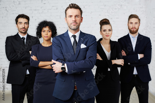 Photo Group of confident, perky lawyers standing together