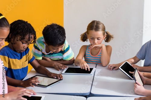 Fotografie, Tablou  Children using digital tablets