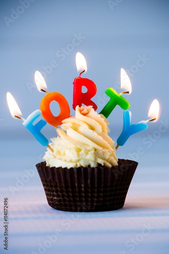 Photo  cupcake with a candles for 40 - fortieth birthday
