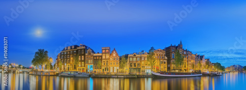 Amstel river, canals and night view of beautiful Amsterdam city Wallpaper Mural