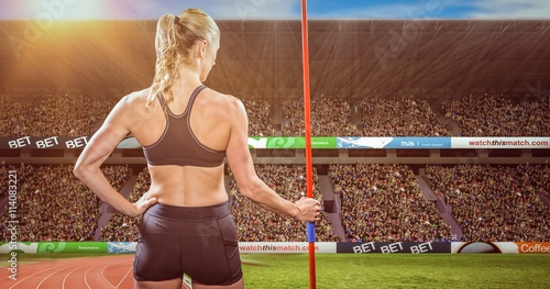 obraz lub plakat Composite image of athlete standing with javelin