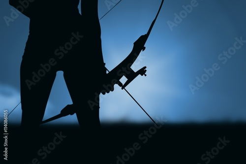 Fotografering Composite image of focus on sportswoman holding an arch