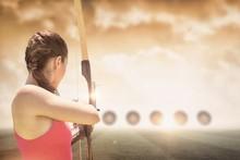 Rear View Of Sportswoman Doing Archery