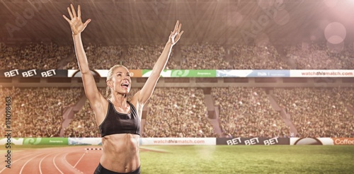 Female athlete posing after victory