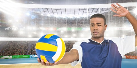 FototapetaComposite image of sportsman playing a volleyball