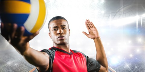 Fototapeta Sport Composite image of sportsman playing a volleyball