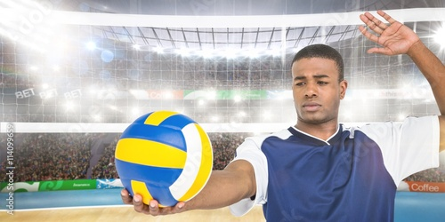 Composite image of sportsman playing a volleyball - 114099659