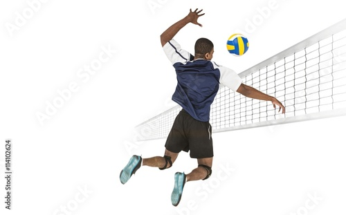 Rear view of sportsman posing while playing volleyball - 114102624