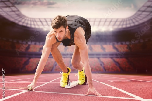 fototapeta na drzwi i meble Composite image of sportsman starting to sprint