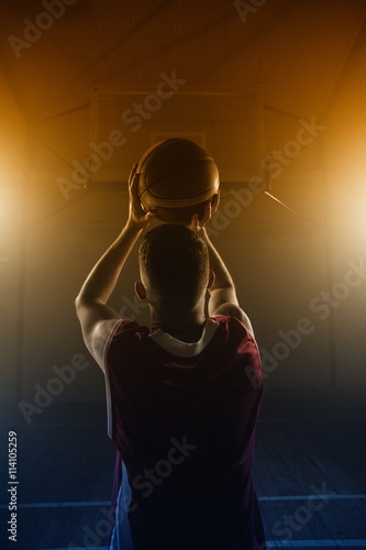 Portrait of basketball player front the back preparing to score Canvas Print