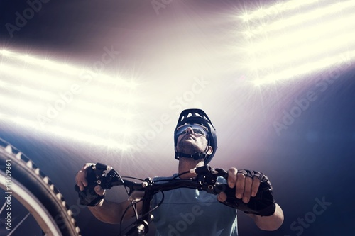 Composite image of man cycling with mountain bike Poster