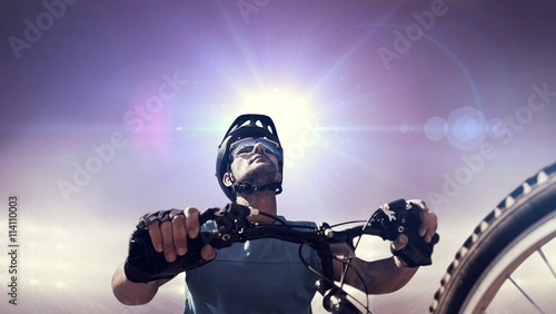 Fotografía  Composite image of man cycling with mountain bike