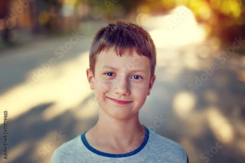 Happy little boy in sunset vintage