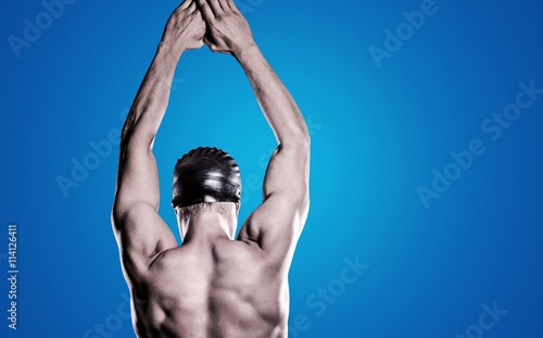 Composite image of swimmer preparing to dive Wallpaper Mural