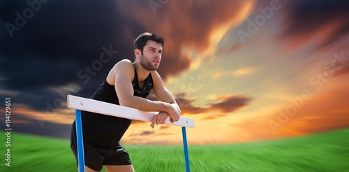 Fotografie, Tablou Composite image of athletic man pressed on a hurdle posing