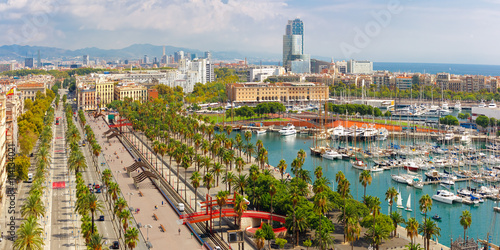 Foto auf Acrylglas Barcelona Aerial panoramic view over Passeig de Colom or Columbus avenue, La Barceloneta and Port Vell marina from Christopher Columbus monument in Barcelona, Catalonia, Spain