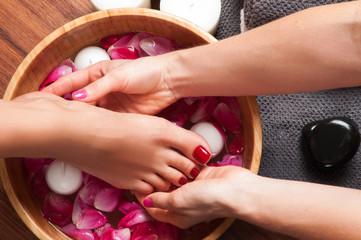 FototapetaMassage of woman's foot in spa salon