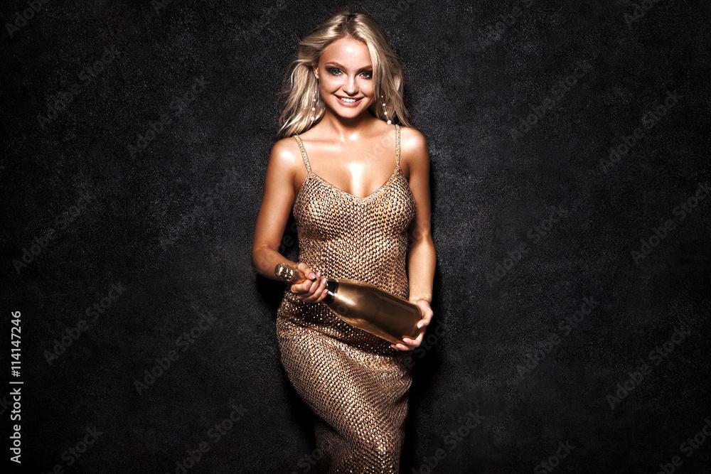Fotografie, Obraz  Beautiful sexy blonde woman on black background, party.