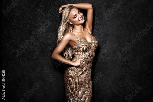 Fototapeta  Beautiful sexy blonde woman on black background, party.