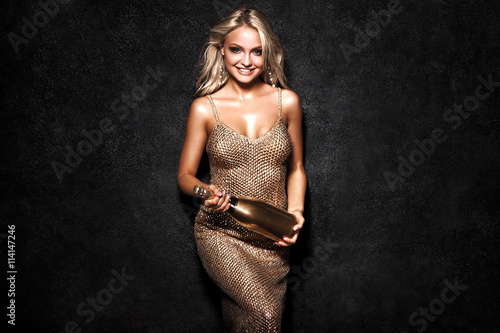 Beautiful sexy blonde woman on black background, party. Fotobehang