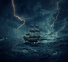 Vintage, Old Sailing Ship Lost In The Ocean In A Rainy, Stormy Night With Lightnings In The Sky. Adventure And Journey Concept