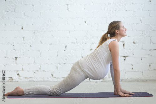 Pregnancy Yoga And Fitness Young Pregnant Yoga Model Working Out In Loft Room With White Walls Pregnant Fitness Person Practicing Yoga Exercises At Home Prenatal Lizard Dragon Yin Pose Posture Buy