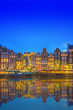 Leinwanddruck Bild - Amstel river, canals and night view of beautiful Amsterdam city. Netherlands