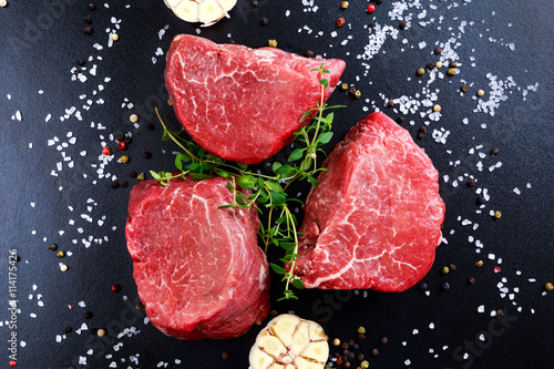 Fresh Raw Beef steak Mignon, with salt, peppercorns, thyme, garlic Fototapeta