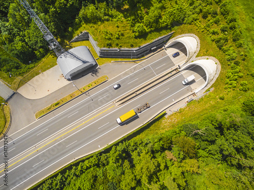 Papiers peints Tunnel Aerial view of highway tunnel in mountains. Traffic on the road. Transportation from above. Industrial background.