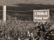 Sepia Private Keep Out Sign On Barbed Wire Boundary Fence To Farmland