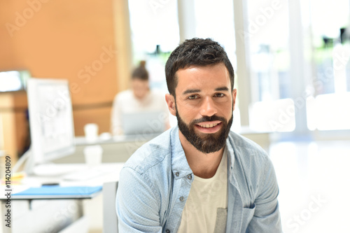 obraz dibond Portrait of trendy businessman in meeting room