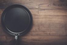 Big Frying Pan On The Table Ba...