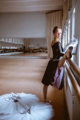 Fototapeta The young modern ballet dancer posing against the room background