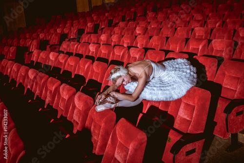 fototapeta na lodówkę Ballerina sitting in the empty auditorium theater