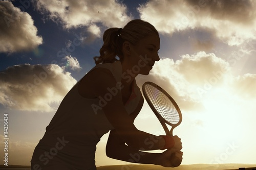 Canvastavla  Composite image of athlete playing tennis with a racket