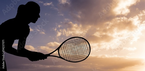Photo  Composite image of tennis player playing tennis with a racket