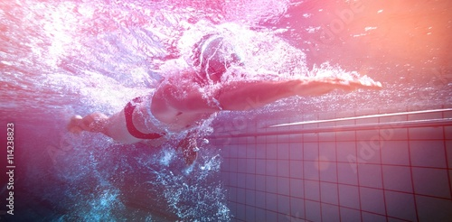 Fit swimmer training by himself Wallpaper Mural