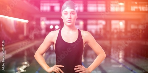 Fit woman in swimsuit with hands on hips Wallpaper Mural
