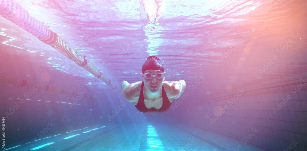Photo  Athletic swimmer training on her own